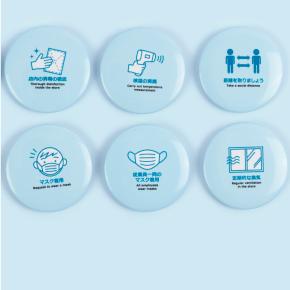 商品アイデア2の注意喚起メッセージを入れた缶バッジ
